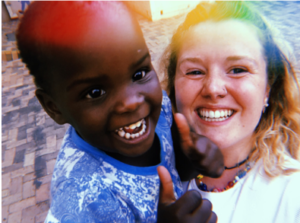 Sorcha Dempsey-Roberts and one of the children in the Sandra Jones Centre, Zimbabwe, July 2019